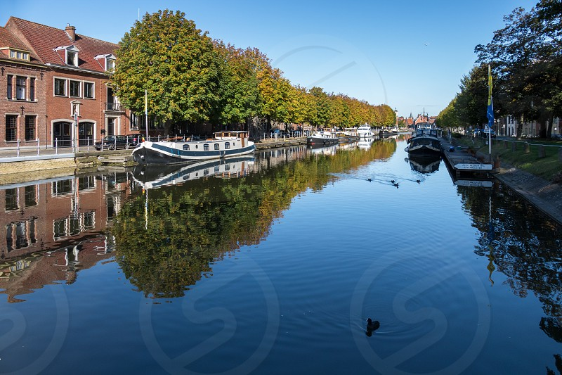 View down a canal in Bruges West Flanders Belgium photo