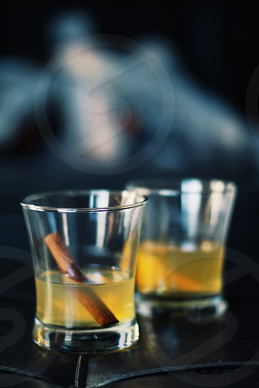 Hot toddy rye whiskey honey boiling water orange grind cinnamon hot drink photo