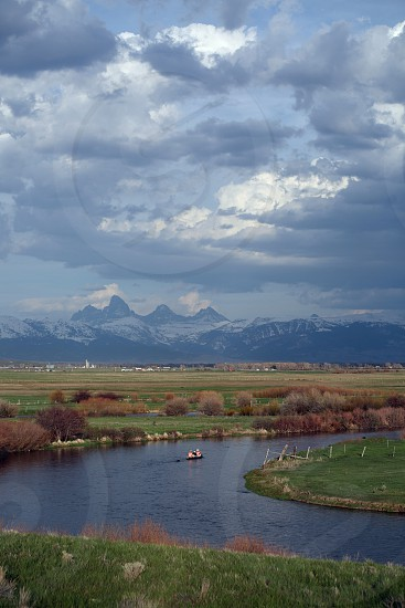 Canoeing Teton River with Grand Tetons in background photo