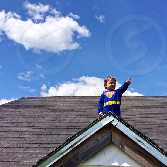 boy on roof of home photo