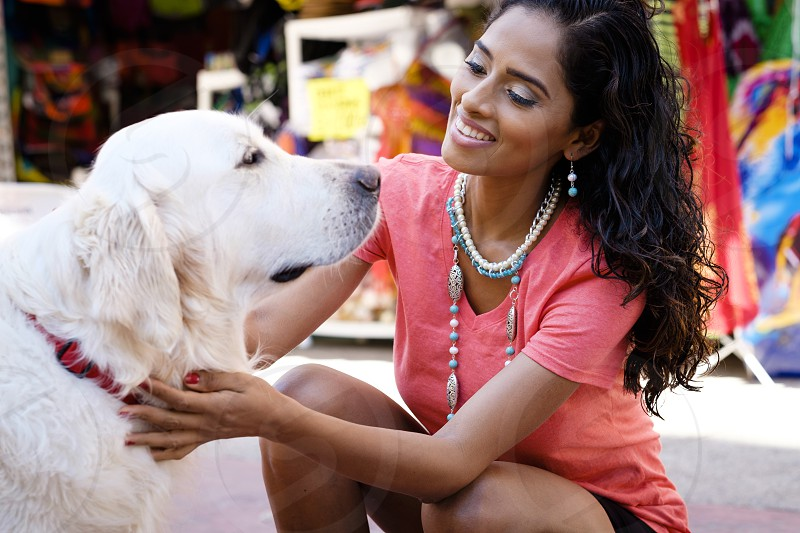 Hispanic woman with Golden Retriever dog at a street market in Puerto Vallarta Mexico photo