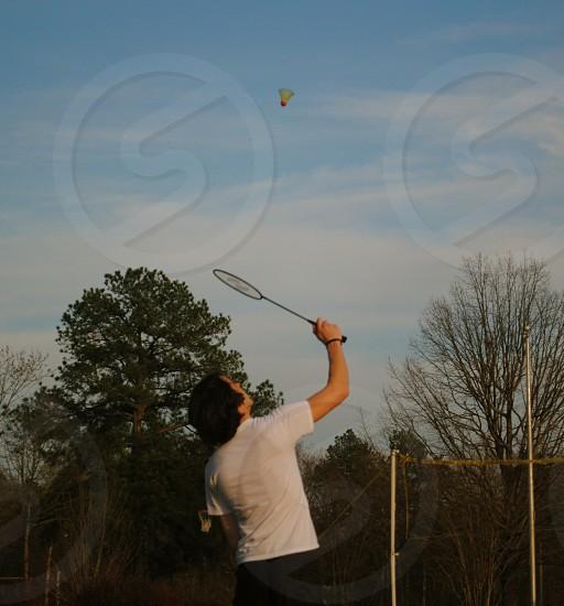 Man playing badminton. photo