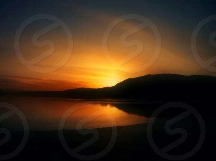sun setting down photo
