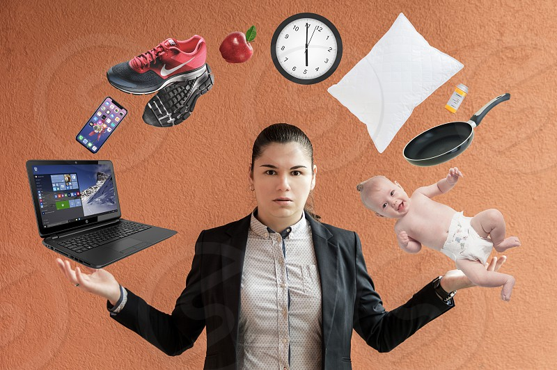 Business woman juggling responsibilities photo