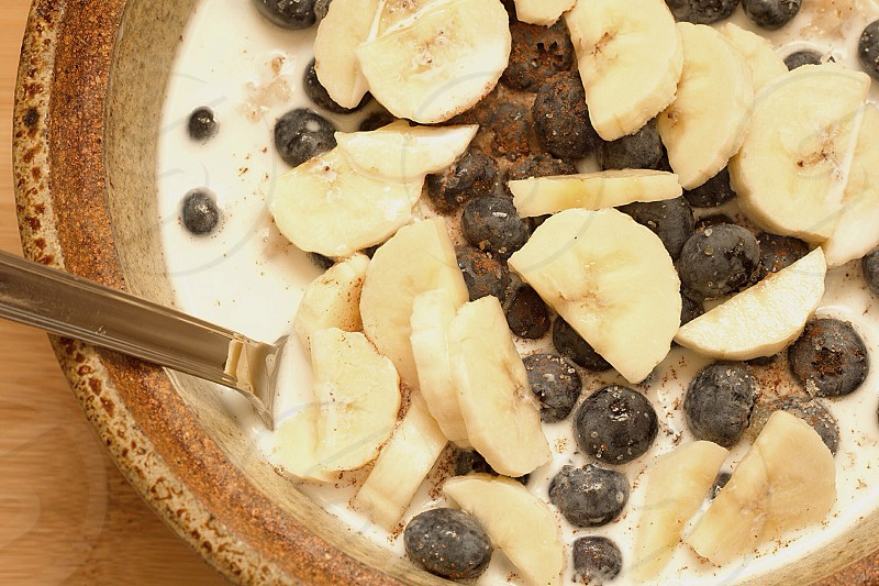 Oatmeal with bananas blueberries and milk  photo