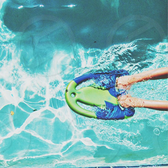person holding green and blue swimming device photo