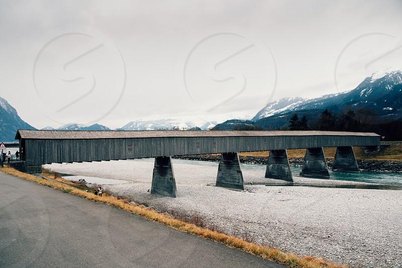 Old wooden bridge crossing the Rhine between Lichtenstein and Switzerland photo
