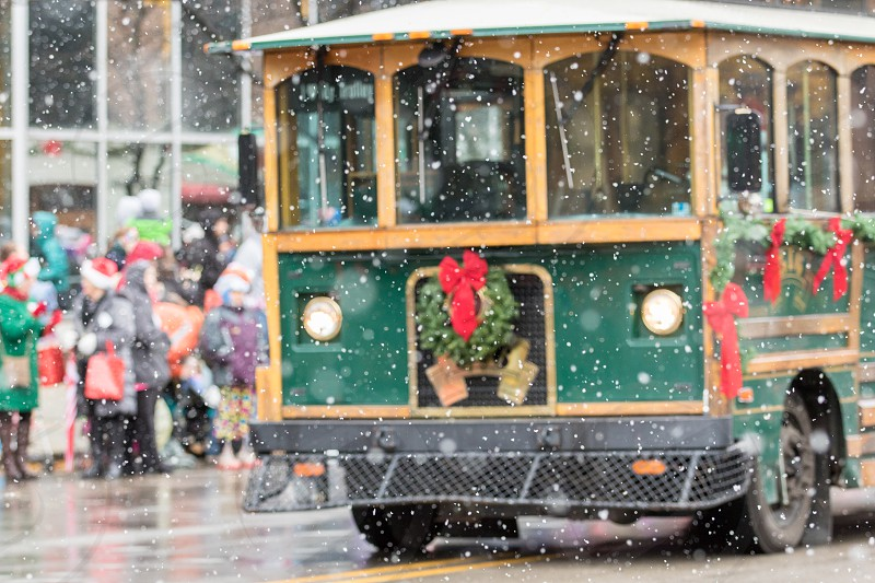 A holiday trolley decorated for the Santa Christmas parade photo