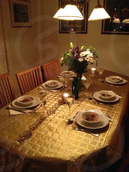 white ceramic bowl on white ceramic plate on brown table photo