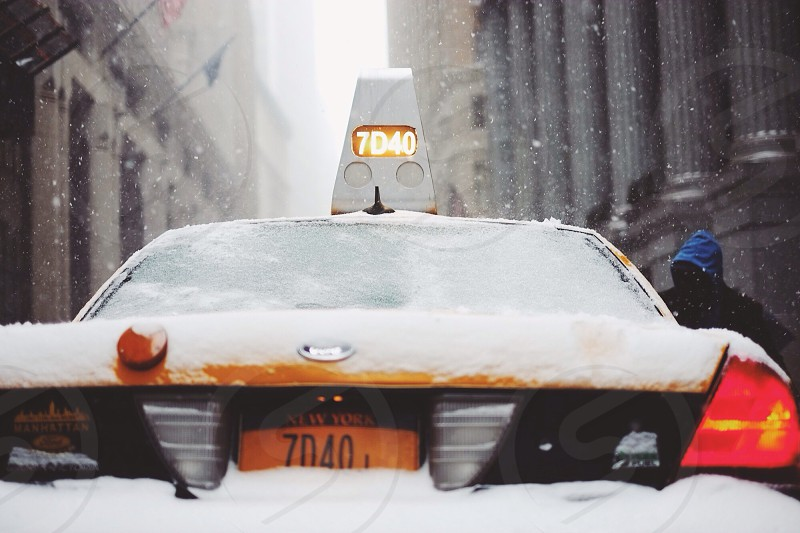 taxi cab covered with snow photography photo