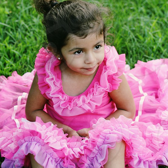 girl in pink lacy dress photo