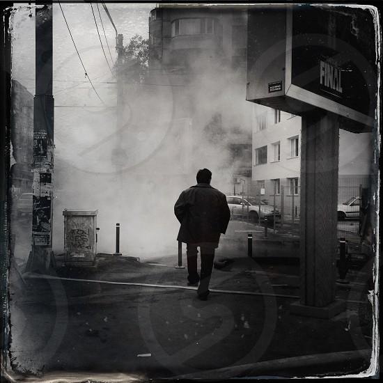 man wearing a gray jacket  photo