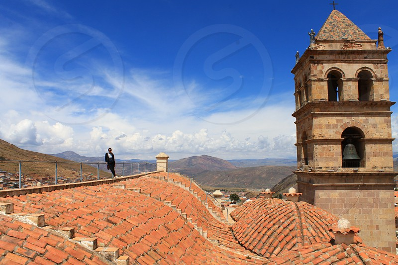 climbing to the tallest building in potosi a mining town bolivia that was once the wealthiest city in the world. photo