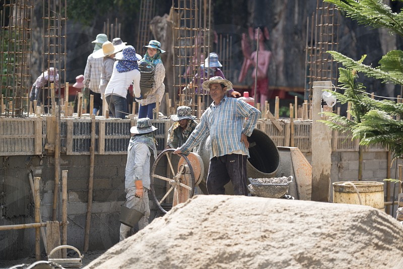 women at a construction of a house near the city Chiang Rai in North Thailand. photo