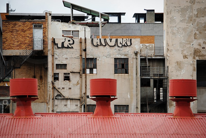 Architecture downtown Johannesburg Fox Street Market on Main Arts on Main inner city urban red corrugated roof vents graffiti.  photo