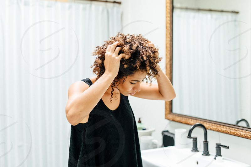girl doing her hair and getting ready photo