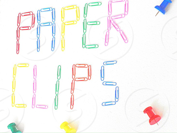 "Multi Colored paper clips spelling the words ""paper clips"" on a wite background photo"