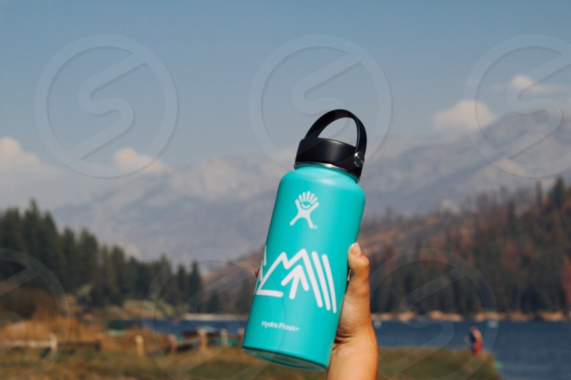 blue water tumbler on hand photo