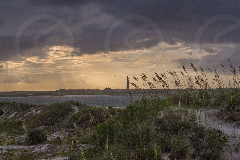 dunes lighthouse ponce inlet river sunset port orange inter coastal waterway photo