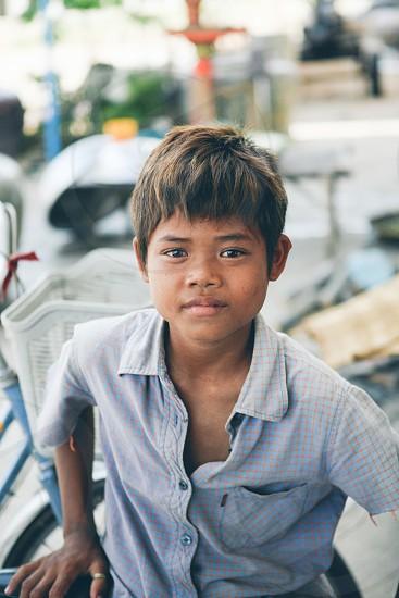 boy's light blue short sleeved button down shirt photo