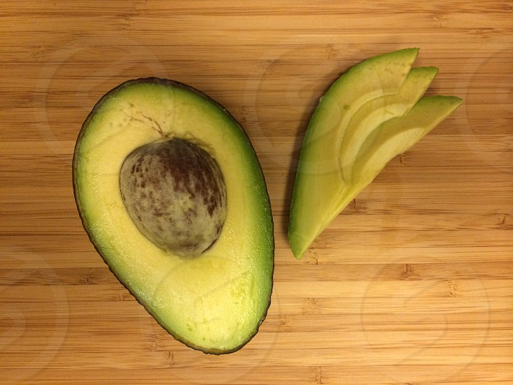 Avocado on wood surface slices green photo