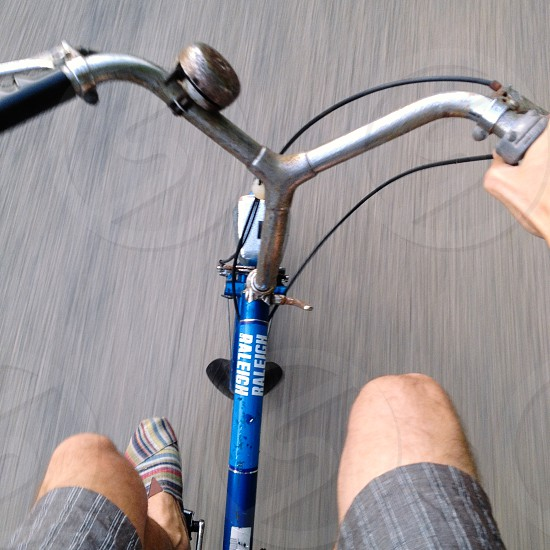 blue and stainless steel bike photo