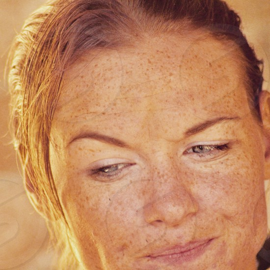Woman young woman frowning candid expression no makeup pretty redhead freckles photo