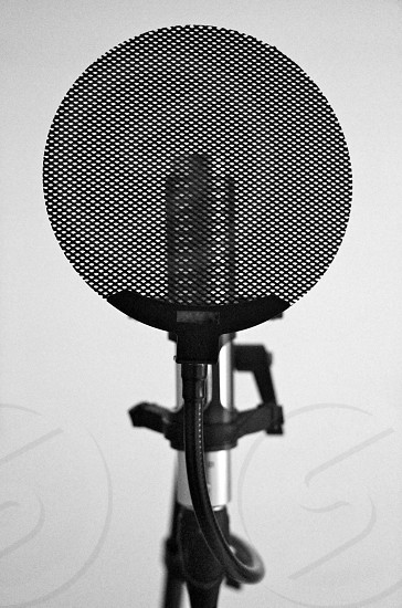 microphone in greyscale photography photo