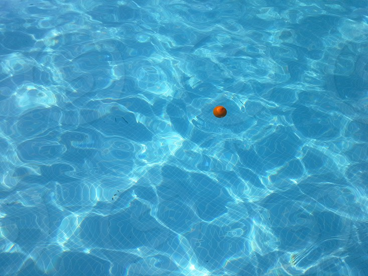 Orange ball at the swimming pool photo