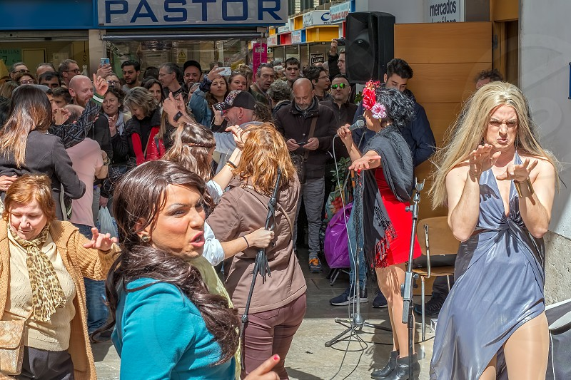 Malaga Spain - March 24 2018. Celebrating and dancing people in the central market photo