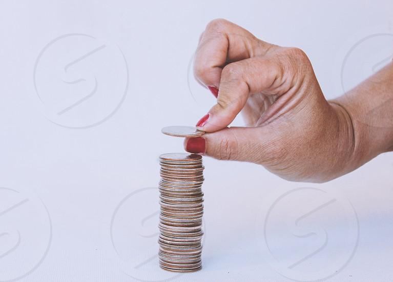 Saving money coinsquarters  photo