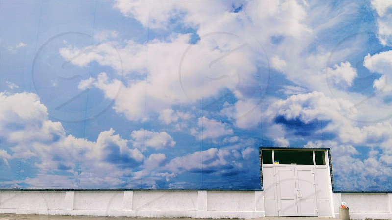 blue sky with white clouds wall painting photo