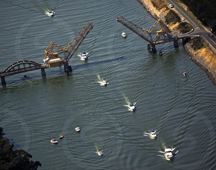 A flotilla of boats pass under a drawbridge on the Sacramento River in the California Delta the west's largest estuary that provides water for 23 million Californians. photo
