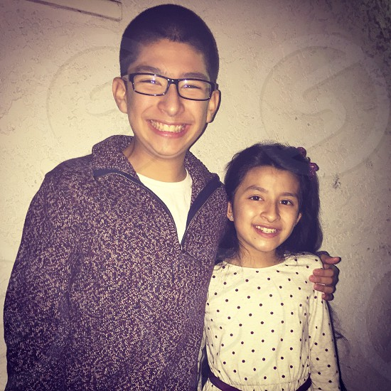 Siblings.    Brother and sister.  Family first  photo