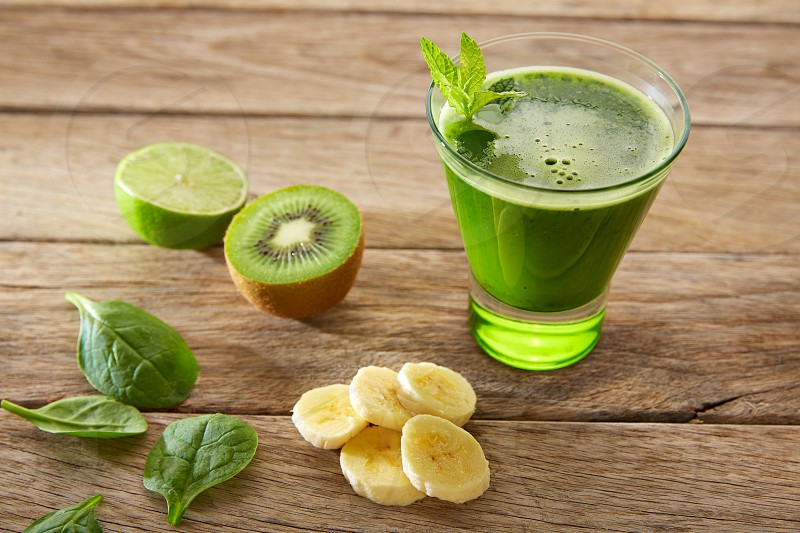 Detox green juice cleansing recipe with also kiwi lemon cucumber spinach photo