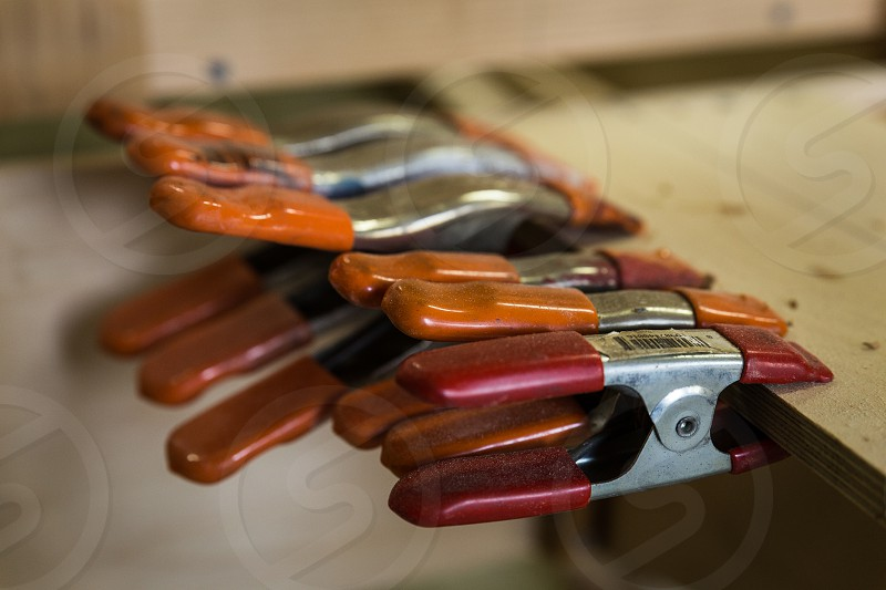 Organized spring clamps used for woodworking. clamps clamp tool tools wood woodworking craftsmanship craft photo