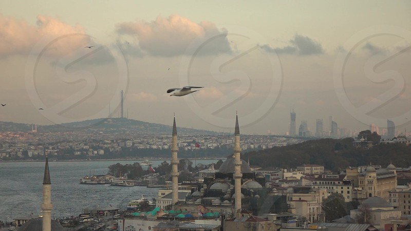 Aerial view of Istanbul city Turkey Rustem Pasha Mosque at Eminonu Bosphorus strait on a background cloudy sky day time with sunny weather. Slow motion Full HD video 240fps 1080p. photo