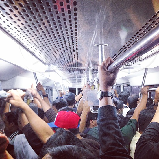 people standing inside a train photo