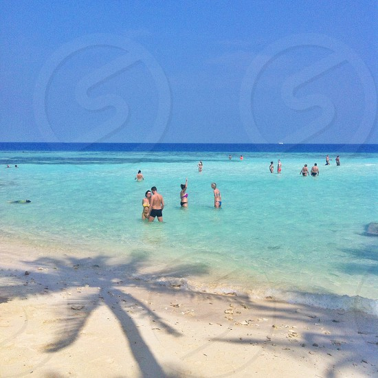 view of people in a white sand beach photo