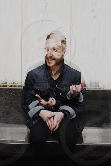 man in a denim jacket photo