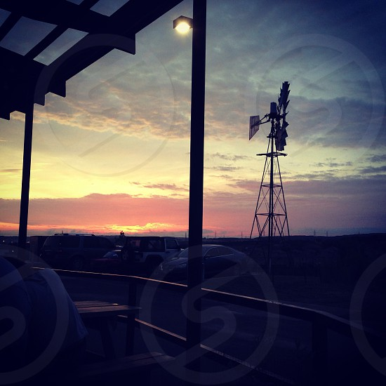 Sunset with windmill silhouette.  photo