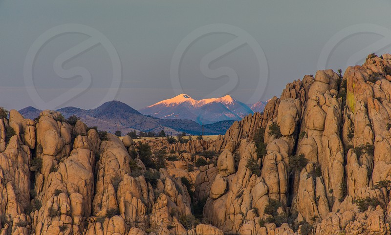 Taken at Watson lake showing the San Francisco peaks at sunset in the background. photo