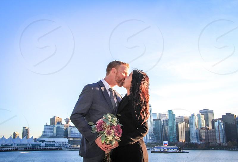 Beautiful wedding ceremony with cityscape photo