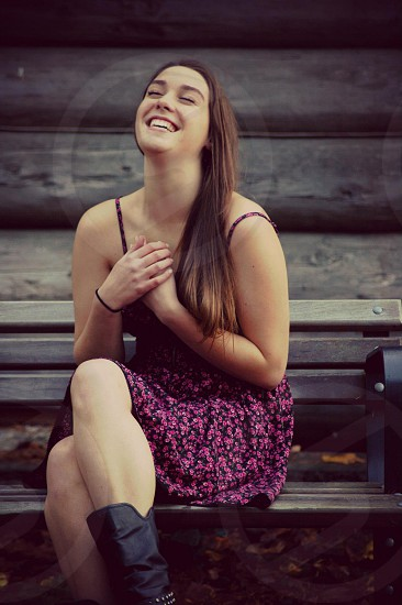 Laughing on a park bench photo