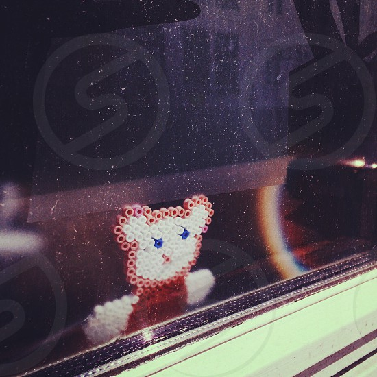 pink and white bear fashion bead stick on clear glass window photo