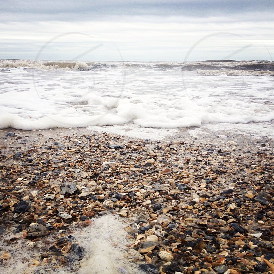 stones and sea shore panoramic photography photo