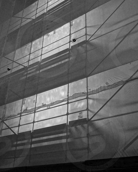 grayscale photography of building construction site photo
