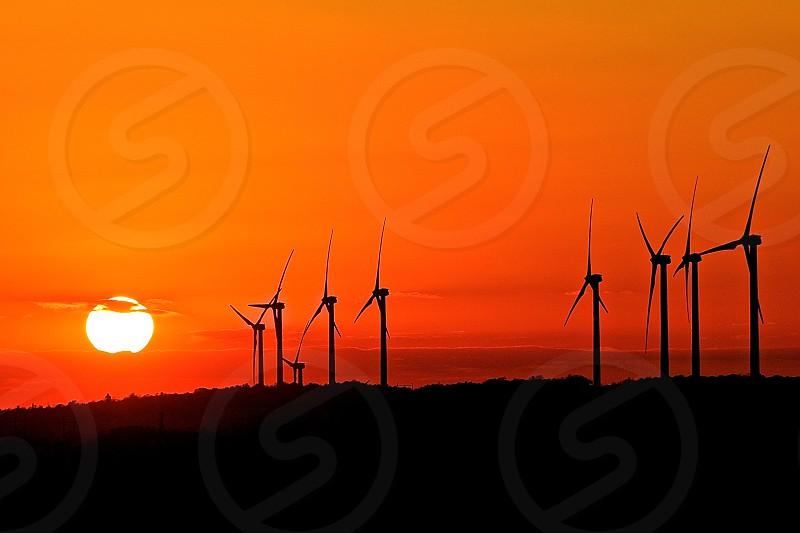 sun wind mills red orange dark sun photo