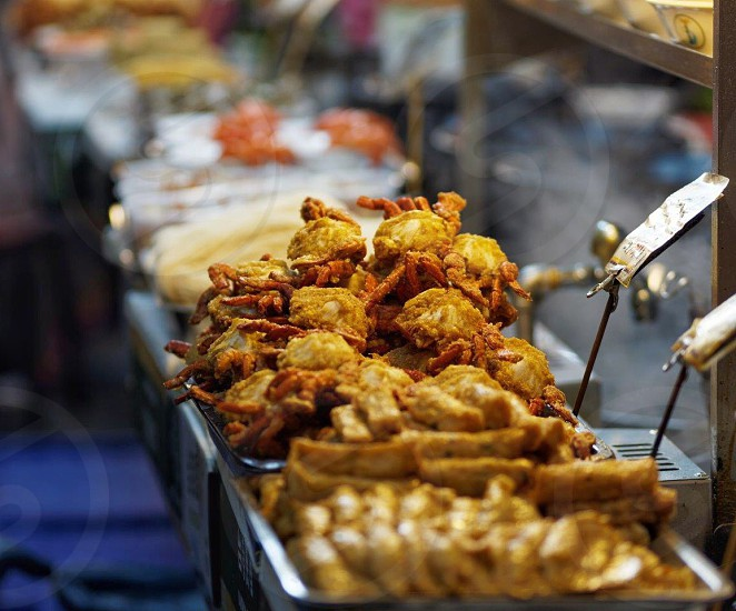 fried crabs with street foods on display photo