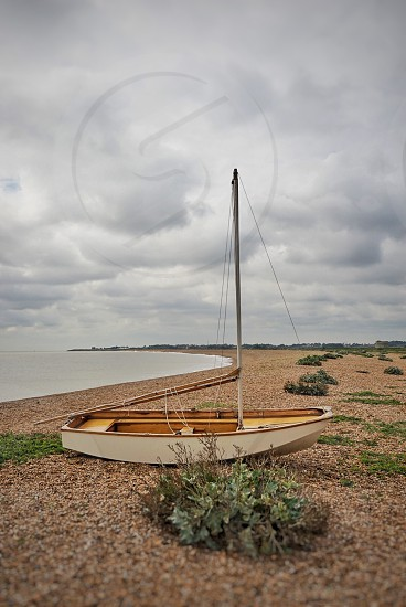 Boat on a pebble beach in Suffolk England photo